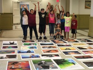 "Youth getting a look at their images for the ""Through Our Eyes"" photo exhibit (photo by Kristine Sorensen)"