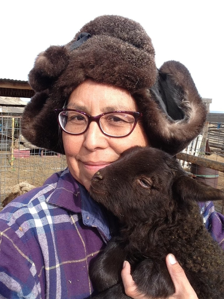 TahNibaa Naataanii of the Navajo Nation with one of her lambs, in Table Mesa, New Mexico