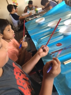 Pyramid Lake Paiute youth make hand game pieces during the camp