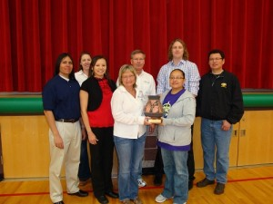 Pinnacle Bank staff, Meskwaki Financial Literacy Committee members, and partners pose with the 2012 Financial Literacy Program of the Year Award from the Native American Finance Officers Association in April 2012
