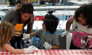 FoodCorps Service Member Shanae Vega works with Head Start youth participants in a hands-on cooking activity as part of the Bishop Paiute Tribe's Food Sovereignty Program nutrition education classes.