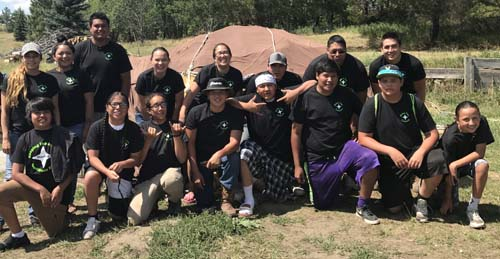 Star Boy Camp participants in front of the Arikara sweat lodge that was constructed by the Star Boys who attended the camp in August 2017