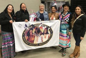 Medicine Lodge Confederacy members hold the Mandan Hidatsa Arikara Nation flag at a youth conference held by the MHA Education Department in September 2017. The MLC members presented at the conference attended by more than 600 high school students throughout the Fort Berthold Indian reservation