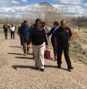 Maxine Toya of Jemez Pueblo (far left) and Jason Garcia of Santa Clara Pueblo (front right) walk and reflect on what their art means to them and their communities