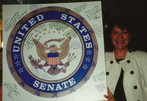 Gower with her going-away present, a U.S. Senate seal with signatures from all Senate Committee on Indian Affairs staff.
