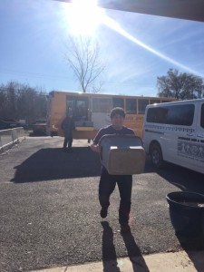 """Iawekon Nutrition for Kids"" program food bags are unloaded from the school buses to the Akwesasne Boys & Girls Club to feed hungry kids."
