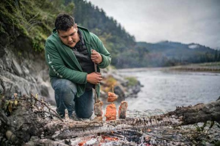 "Photo of Sammy Gensaw (Yurok) with salmon, by Renan Ozturk. Image was taken as part of the ""Gather"" film and storytelling project about Native American food sovereignty."