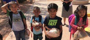 "Students from the Moencopi Day School receive food ingredients for recipes as part of the Take and Make Healthy Food packs and ""Nourishing Native Children: Feeding Our Future"" Project."