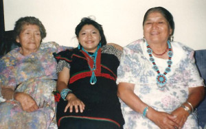 Monica with her maternal and paternal grandmothers at her college graduation in 1996.