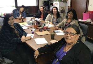 Holly Doll, Willow Doll, Stacey LaCompte of North Dakota Indian Business Alliance, Taylor Wilkinson, Shawna Fricke, Emma Goodhouse-Doll, and Cheryl Ann Kary (not pictured) of Sacred Pipe Resource Center discuss next moves for Native Artists United.