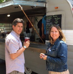 "Mike with Jona Charette, First Nations Development Officer, at the ""taco truck"" during a staff meeting in 2017."