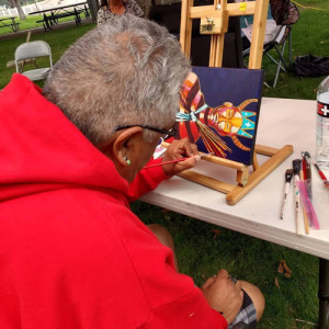 Ric Gendron paints intently at the art show.