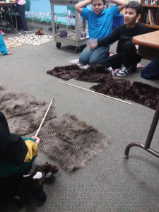 Young boys learn more about their culture and themselves through activities like the Moccasin Game.
