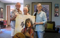 Karen, right, with Jim and Sandy Heuerman, with a piece the Heuermans purchased.