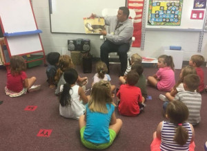 Executive Director Monte Randall says SONS serves to give back to the Muscogee Tribe. Here, a SONS volunteer reads to students at Glenpool Elementary School.