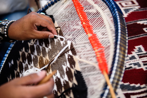 "Teaching and sharing textile fiber arts is imperative in passing down the Navajo way of life. Pictured here is ""Round Rug Weaving"" by Antonio Chiquito, a Navajo weaver."