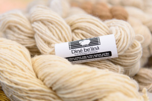 The organization fosters an entrepreneurship economy for sheep producers, weavers, wool processors and fiber artists. Pictured is hand-spun Navajo Churro yarn, one of the Diné Be'iiná products.