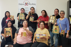 Parfleche is one of the traditional artforms the organization has been able to perpetuate. Here parfleche workshop participants display their finished projects.