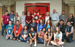 Northern Arapaho youth, chaperones and Sister Cities personnel at the Longmont Civic Center.