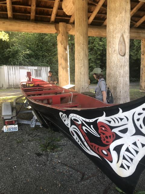Attendees view a traditional canoe at Squaxin Island Museum Library and Research Center.