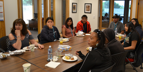 The youth listen to a brief presentation at First Nations, along with chaperones Jana Grey at right, and Grayson Medicine Cloud in the back of the room.