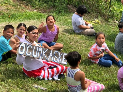Students learn to speak and understand the Lakota language through gardening, food preparation, and learning about traditional Lakota plants, sustainability, and ecology.