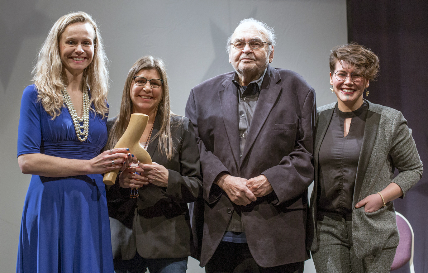 The CRCC earned the 2019 Arts and Humanities Award in the field of Distinguished Service to Education from the Governor of Alaska. Pictured here with the award are: (From left to right) Kelly Tshibaka, Commissioner of the Alaska Department of Administration; Patty Schwalenberg, Executive Director of CRRC; Robert Heinrichs, current CRRC Board Member from the Native Village of Eyak; and Beth Pipkin, former Board member from the Chenega IRA Council.